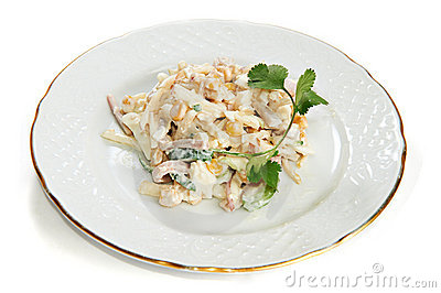 Squid salad with corn, eggs, apples isolated