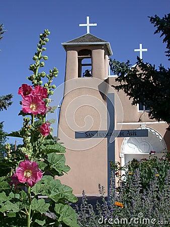 Free St. Francis Of Asisi Catholic Church With Hollyhocks Stock Photo - 1046500