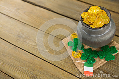 St. Patricks Day shamrock, flag and pot filled with chocolate gold coins Stock Photo