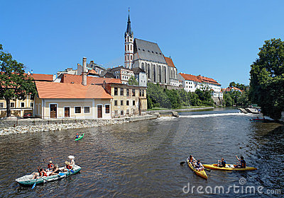 St. Vitus cathedral and rafting on Vltava river Editorial Stock Image