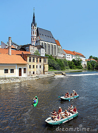 St. Vitus cathedral and rafting on Vltava river Editorial Photo