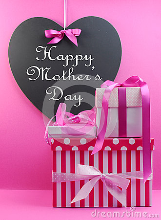 Stack of beautiful pink presents with Happy Mothers Day message