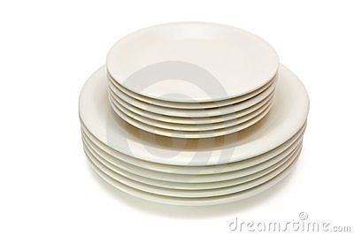 Stack of beige plates and saucers