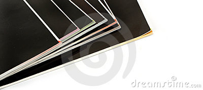 Stack of black covered magazines