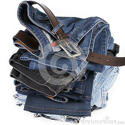 Stack of blue jeans with brown belts
