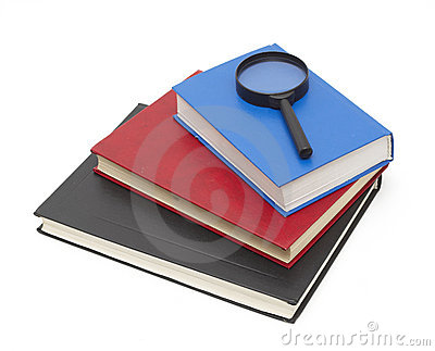Stack of books and magnifying