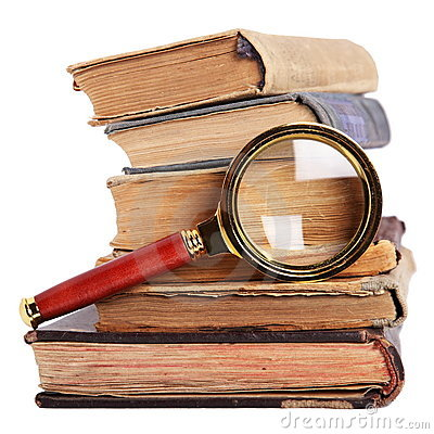 Stack of books, magnifying glass