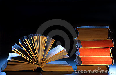 Stack books, open book and copyspace.