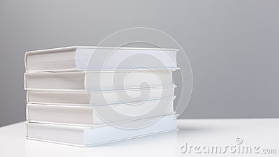 Stack of books on a white desk
