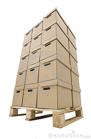 Stack of carton  boxes put in tower on wooden pale