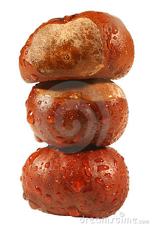 Stack of chestnuts with raindrops