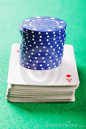 Stack of chips on card deck