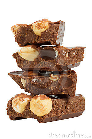 Stack of chocolate pieces  with hazelnuts