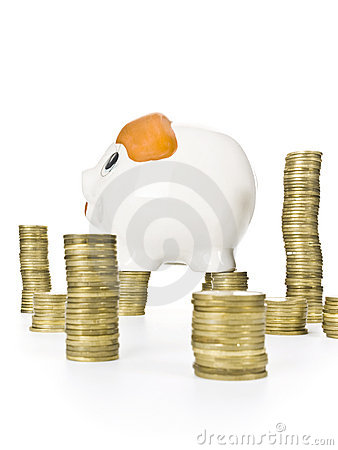 Stack of coins with piggy bank