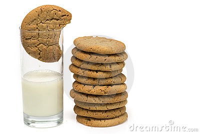 Stack of cookies beside milk
