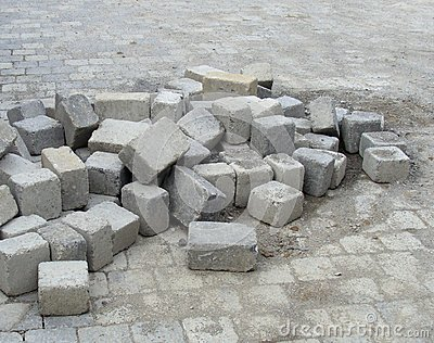 Stack of cubic tile laying on pavement