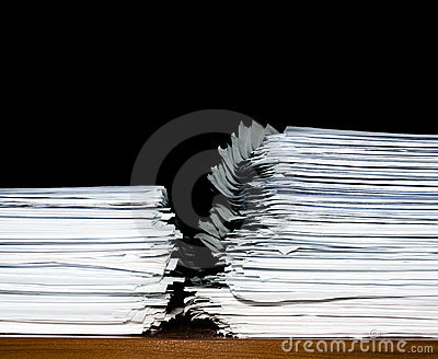 Stack of documents or files, overload of paperwork