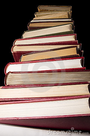 Stack of encyclopedia books over black background