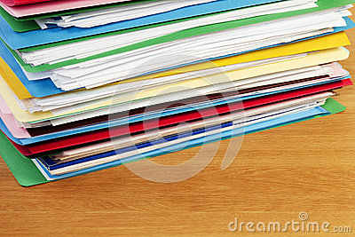 Stack of Files On Wood Surface Horizontal