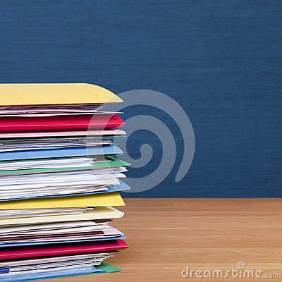 Stack of Files on Wood Surface Square