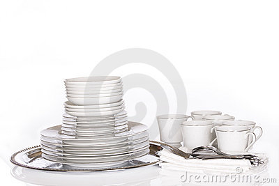 Stack of fine dishes on silver tray