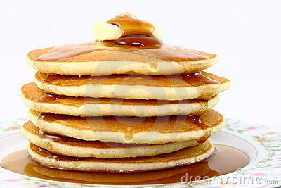 Stack Of Fluffy Pancakes With Butter And Syrup