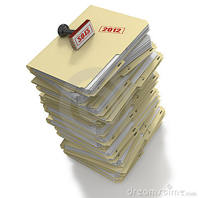 Stack of manila office folders or files on white b