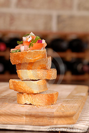 Free Stack Of Bruschetta With Wine Rack In Background Royalty Free Stock Photo - 1823405