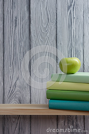 Free Stack Of Colorful Books And Green Apple On Wooden Table. Back To School. Copy Space Stock Images - 57772844