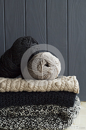 Free Stack Of Warm Clothes From Knitted Knitwear Over Grey Wooden Background Royalty Free Stock Image - 78114516