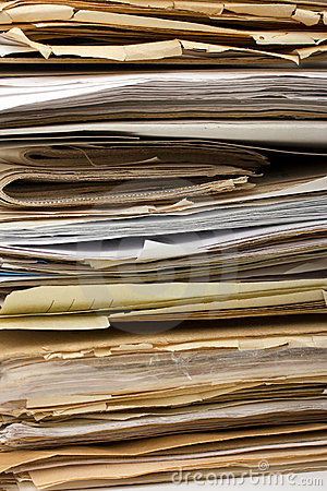 Stack of old paper files as background
