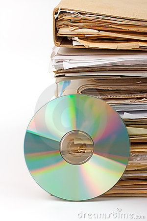 Stack of old paper files and  cd