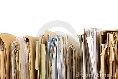 Stack of old paper files. Horizontal view