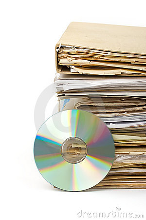 Stack of old paper files and modern archive on cd