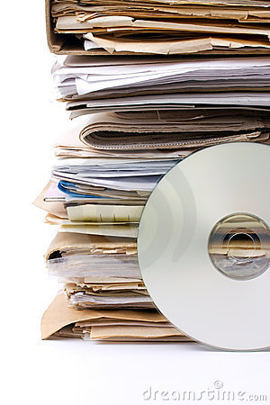 Stack of old paper files and modern cd archive