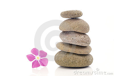 Stack of pebbles with pink flower