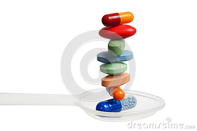 Stack of pills on a spoon