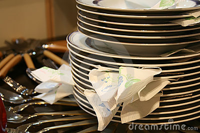 Stack of plates and utensils