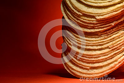 Stack of Potato Chips on Orange