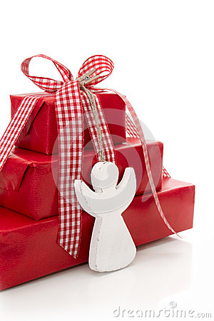 Stack of red Christmas presents with white angel i
