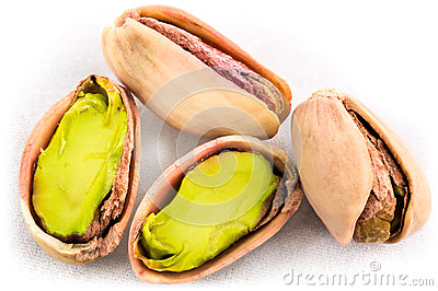 A stack of roasted pistachios on white