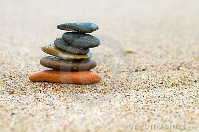 Stack of stones on sand