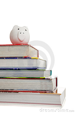 Stack of textbooks with a white piggy bank