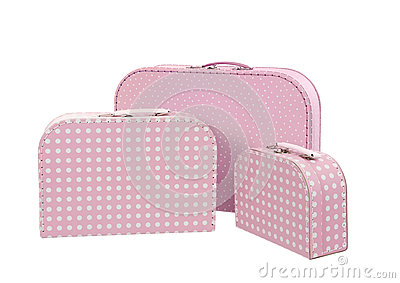 Stack of three suitcases, pink with white dots