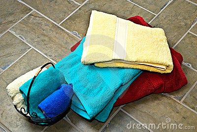 Stack of Towels/Tile Floor