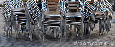 Stacked chairs on decking