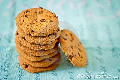 Stacked chocolate chip cookies on blue table set