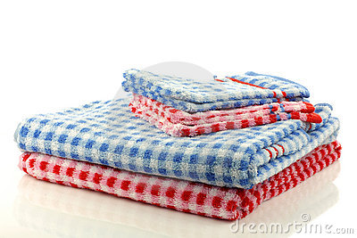Stacked colorful checkered bathroom towels