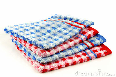 Stacked colorful checkered bathroom wash cloths