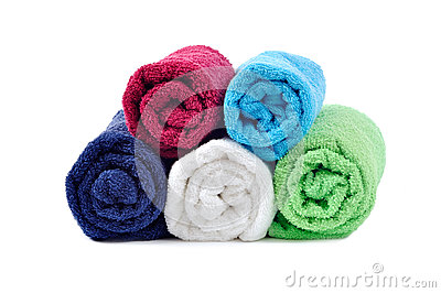 Stacked colorful rolled towels